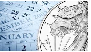 Silver coin on calendar
